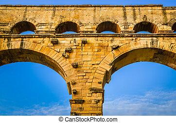 Detail of Pont du Gard aquaduct bridge pillars, France
