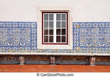 detail of Portuguese house-  window and tiled facde close-up