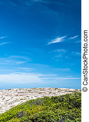 Detail of rocky Australian coastline with blue sky and clouds