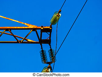 Detail of rusty power tower against deep blue sky
