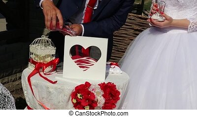 detail of sand ceremony being performed at wedding Ukraine