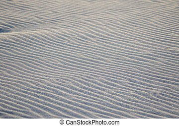 Detail of sand on the beack - light and shadow on fresh wind...