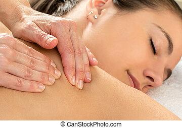 Detail of shoulder massage on woman.