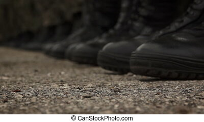 Detail of soldiers black shoes - close up of soldiers in...