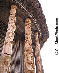 Detail of some ceramics drawing and sculpture on the pillars of a chief house - Cameroon - Africa.