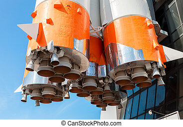 Detail of space rocket engine against the blue sky background