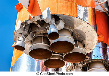 Detail of space rocket engine against the blue sky