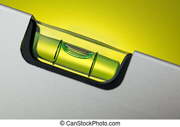 detail of spirit level with spot light on background