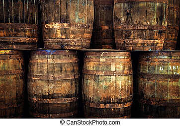Detail of stacked old wooden whisky barrels - Stacked pile ...