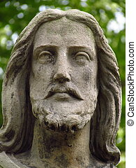 Detail of statue - Christus face on grave in old abadoned cemetary