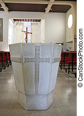 Detail of stone baptistery in the church