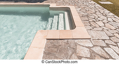 detail of swimming pool in a garden