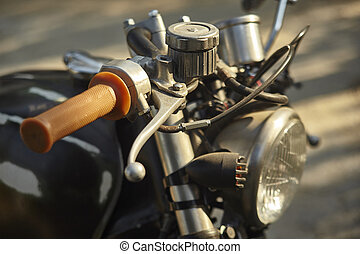Detail of the accelerator of a vintage motorcycle.