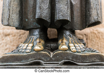 Detail of the bare feet of the sculpture of San Pedro de Alcantara in the cathedral of Santa Maria in the old town of Caceres.