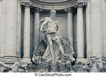 Detail of the central niche of the famous Trevi fountain with the statue of Neptune - Rome, Italy
