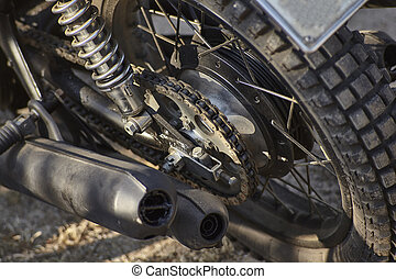 Detail of the chained transmission of a vintage motorcycle.