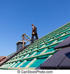 Detail of the construction of a new roof with the roofer ...