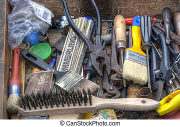 Detail of the drawer full of old tools