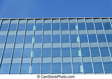 detail of the glass building or glass wall with the blue sky