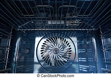 modern oven built with fan - Detail of the interior of a...
