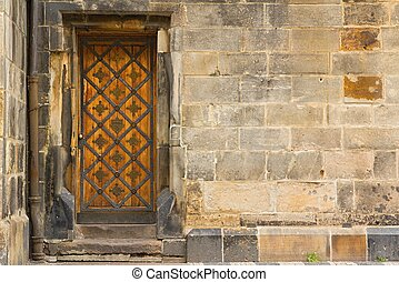 Detail of the old wooden doors in the Old Town of Prague -...