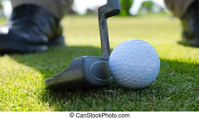 detail of the sportsman's Golf game - Game of golf. Putter...
