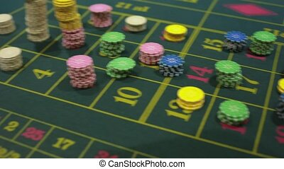 detail of the table game in a casino - croupier and casino...
