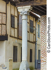 detail of the typical columns with arcades in Arevalo, Spain