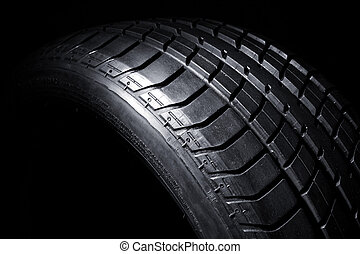 detail of tire - classic tire close up image dark background