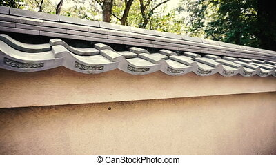 Japanese style vintage concrete wall with roof - Detail of...