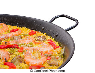 Closeup of traditional spanish paella cooked in a pan, isolated on white background