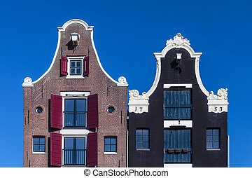 Detail of two Dutch canal houses in Amsterdam