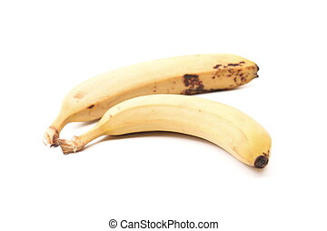 Detail of two old speckled bananas on a white background