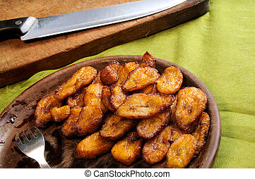 fried bananas - detail of typical cuban dish with fried ...