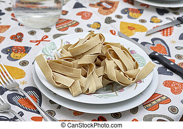 uncooked pappardelle in a plate