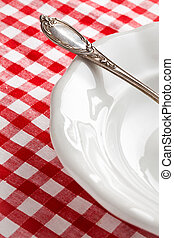 detail of vintage cutlery on white plate