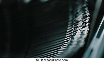 Detail of vintage typewriter metallic letters - Slow motion...