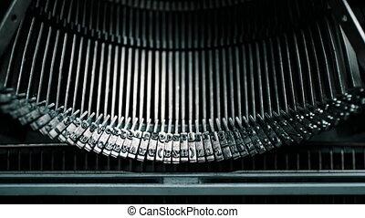 Detail of vintage typewriter metallic letters