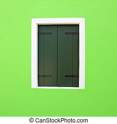 detail of vivid green facade with window