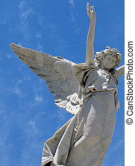 winged angel - Detail of winged angel statue against blue ...