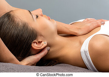 Detail of woman receiving physical neck therapy.