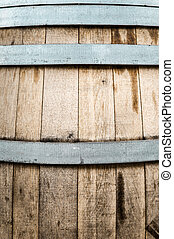 Detail of wooden barrel with metal hoops. - Detail of wooden...