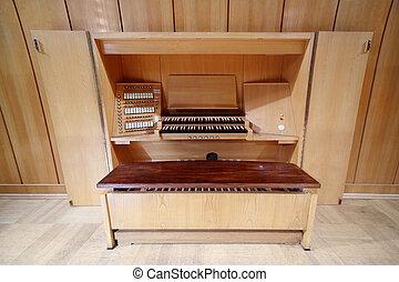detail of wooden control panel of massive Pipe Organ; keys...