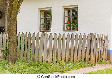 Detail of wooden fence and old house