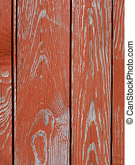 Detail of wooden fence with peeling paint