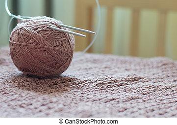 Detail of woven handicraft knit brown sweater