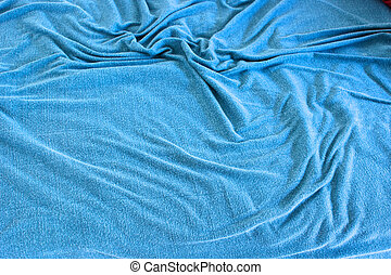 background image of rumpled old blue blanket covered with soft folds