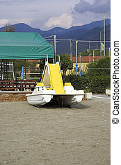yellow pedalo on the beach in italy