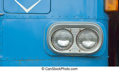 detail on the headlight of a vintage bus