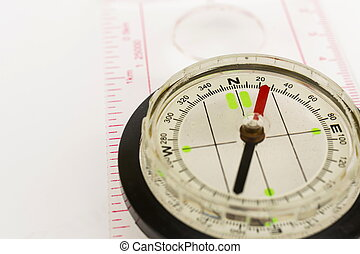 Detail shot of a glass compass on white background